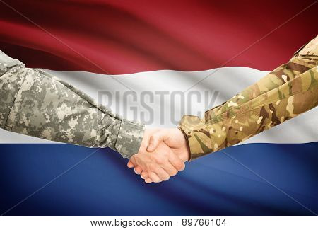 Men In Uniform Shaking Hands With Flag On Background - Netherlands