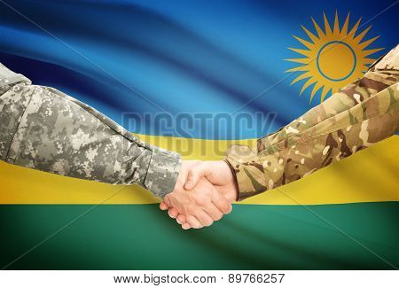 Men In Uniform Shaking Hands With Flag On Background - Rwanda