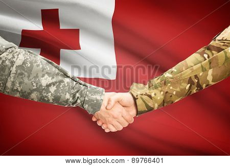 Men In Uniform Shaking Hands With Flag On Background - Tonga