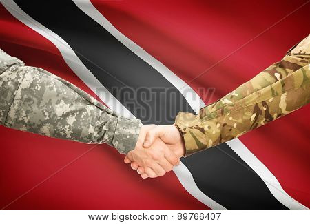 Men In Uniform Shaking Hands With Flag On Background - Trinidad And Tobago