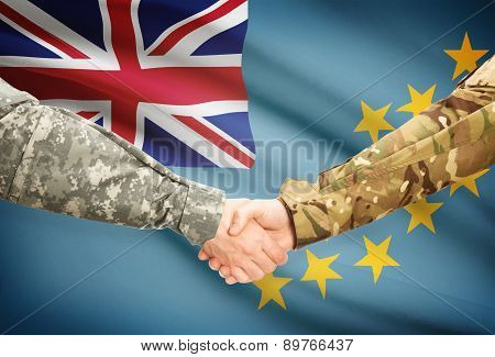 Men In Uniform Shaking Hands With Flag On Background - Tuvalu