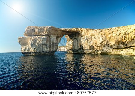 Azure Window, famous stone arch on Gozo island with reflection, Malta
