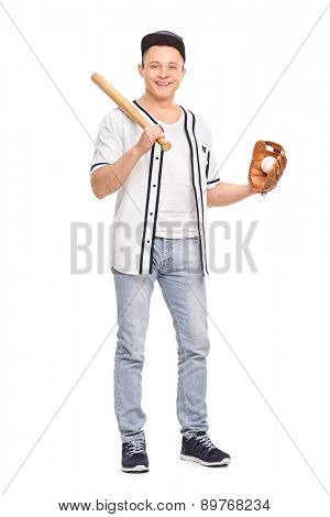 Full length portrait of a young male baseball player holding a baseball bat and a ball isolated on white background