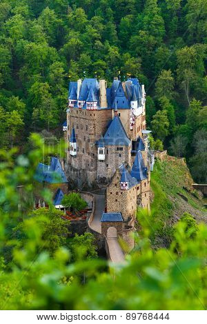 View from hill above of Eltz castle in Germany