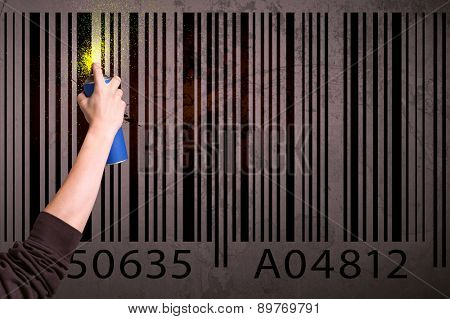 Hand drawing a barcode on the wall