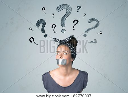 Young woman with taped mouth and question mark symbols around her head