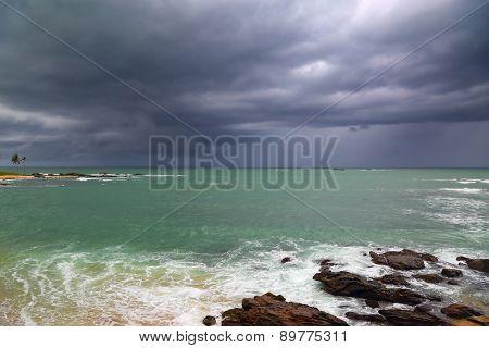 Beautiful sea stormy landscape over rocky coastline in Indian ocean