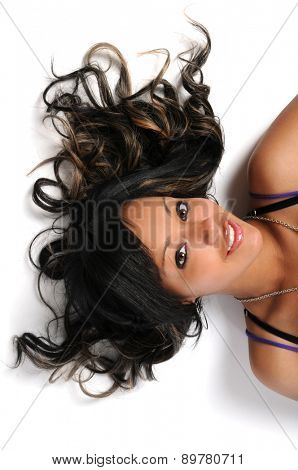 Portrait of beautiful African American woman with hair spread on white background
