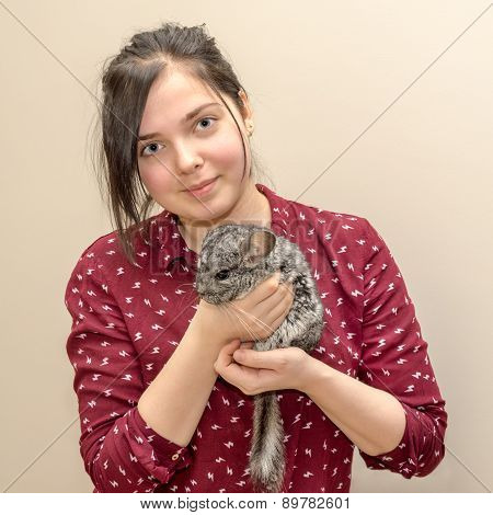 Teenager Caucasian Girl Holding Chinchilla On Her Arms