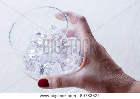 Hand Holding A Glass.