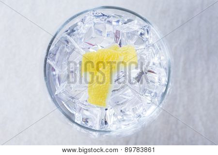 Lemon Peels On A Gin Tonic Glass.