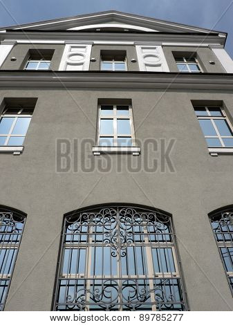 Windows Of Building With Grid At Day