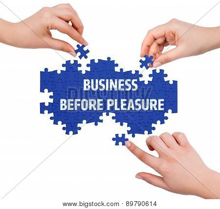 Hands With Puzzle Making Business Before Pleasure Word  Isolated On White