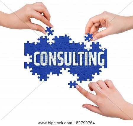 Hands With Puzzle Making Consulting Word  Isolated On White