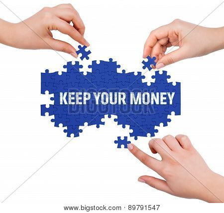 Hands With Puzzle Making Keep Your Money Word  Isolated On White