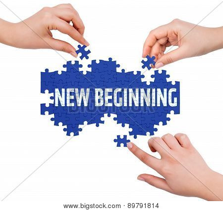 Hands With Puzzle Making New Beginning Word  Isolated On White