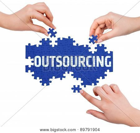 Hands With Puzzle Making Outsourcing Word  Isolated On White