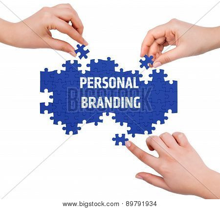 Hands With Puzzle Making Personal Branding Word  Isolated On White