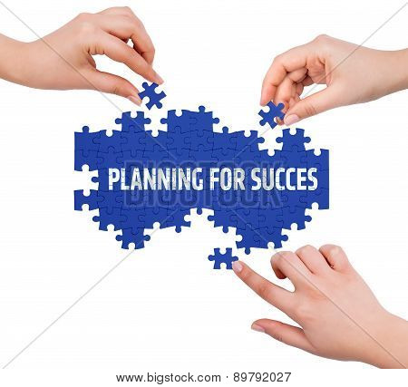 Hands With Puzzle Making Planning For Succes Word  Isolated On White