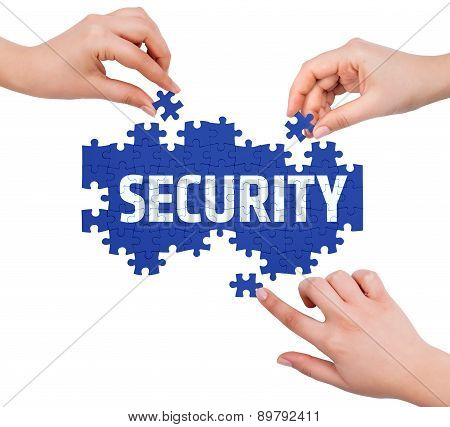 Hands With Puzzle Making Security Word  Isolated On White