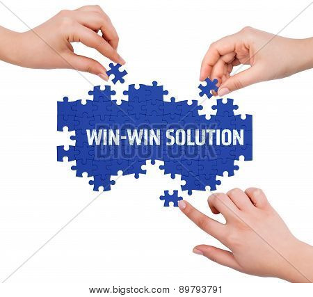 Hands With Puzzle Making Win-win Solution Word  Isolated On White