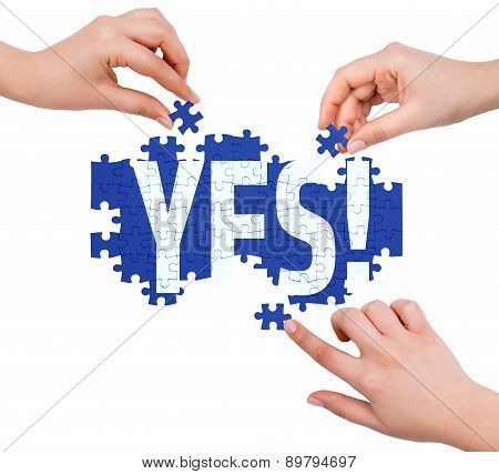 Hands With Puzzle Making Yes Word  Isolated On White