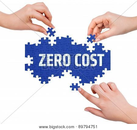 Hands With Puzzle Making Zero Cost Word  Isolated On White