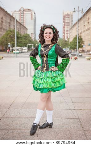 Young Woman In Irish Dance Dress And Wig Posing