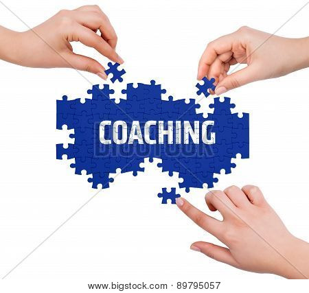 Hands With Puzzle Making Coaching Word  Isolated On White