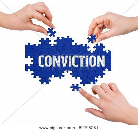 Hands With Puzzle Making Conviction Word  Isolated On White