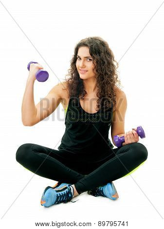girl doing exercises with dumbbells