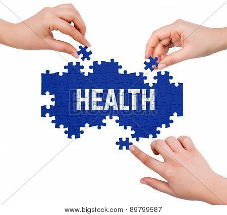 Hands With Puzzle Making Health Word  Isolated On White