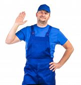 picture of overalls  - Worker in blue overalls - JPG