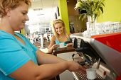 image of fat woman  - Pretty woman taking a break in fitness club - JPG