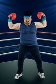 stock photo of boxing ring  - Strong man ready to boxing on the ring at night - JPG