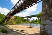 stock photo of virginia  - The James river during low water located within the city limits of Richmond Virginia - JPG