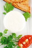 picture of cheese-steak  - soft goat feta salt cheese with grilled sea salmon tomatoes and green lettuce salad served on white china plate isolated on white background - JPG