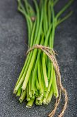 picture of chive  - bunch of fresh chives on a table - JPG