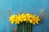 foto of daffodils  - Beautiful bouquet of yellow daffodils on wooden background - JPG