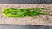 image of chive  - bunch of fresh chives on a table - JPG