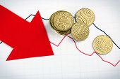 image of paycheck  - Coins and red arrow on graph document close up - JPG
