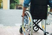 pic of disability  - Detail of a disabled man trying to getting on a ramp - JPG