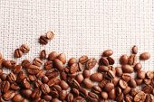 stock photo of sackcloth  - Frame of coffee beans on sackcloth background - JPG