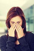 pic of sinuses  - Young woman with sinus pressure pain - JPG