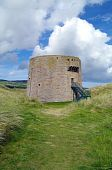 stock photo of martello  - A Martello tower built during Napoleonic times to protect the coast from invasion - JPG