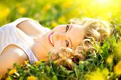 stock photo of lie  - Beautiful Young Woman lying on a field - JPG