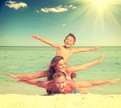 pic of joy  - Happy Family Having Fun at the Beach - JPG