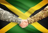 pic of jamaican flag  - Soldiers shaking hands with flag on background  - JPG