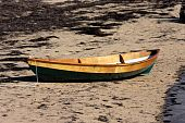 pic of dory  - Beautiful wooden dory sitting on the sand at low tide - JPG