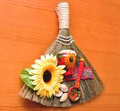 picture of phylacteries  - amulet success broom pinned on a wooden background - JPG